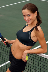 Happy Female Tennis PLayer Flirting with You At the Net