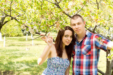Young couple portrait embracing outdoors