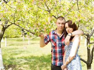 Couple in love posing with the tree
