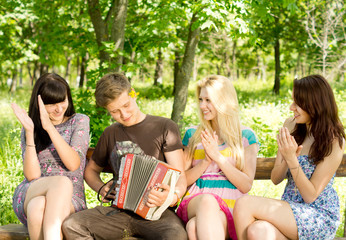 Friends enjoying music played on a concertina
