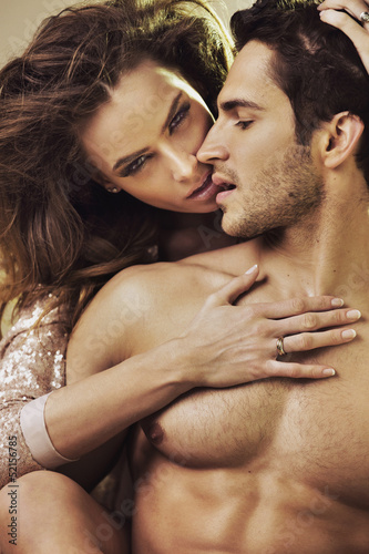 Sensual woman touching her boyfriend's perfect body