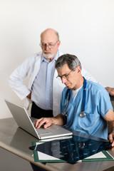 Two Senior Medical Doctors Discussing Patient's MRI Film Scans