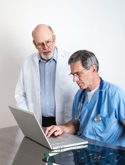 Senior Medical Doctors Discussing Patient's MRI Film Scans