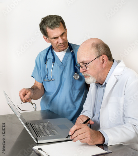 Two Senior Doctors at Laptop Conference