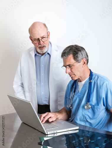 Senior Medical Doctors Discussing Patient's MRI Film Scans
