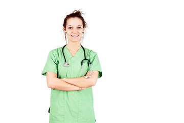 Young woman in green scrubs smiling