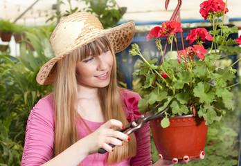 beautiful girl in a greenhouse