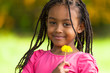 Outdoor portrait of a cute young black girl - African people