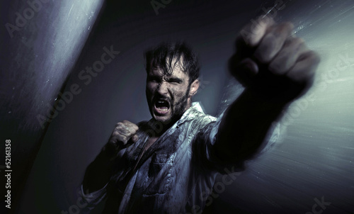 Dirty handsome man fighting for egsistance