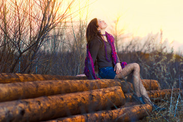 brunette sunlight girl sitting woman outside in a group timber p