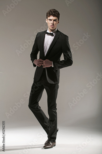 Smart young model in fashion pose