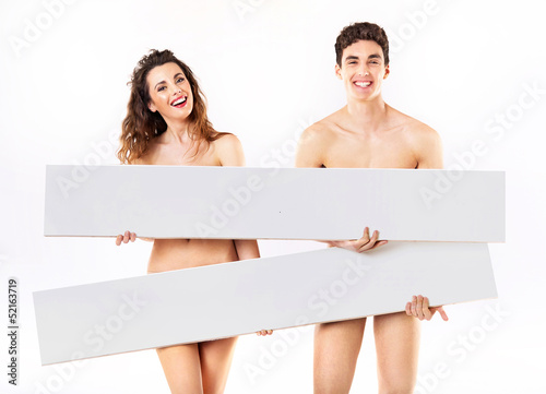Laughing nude couple  with empty adverts