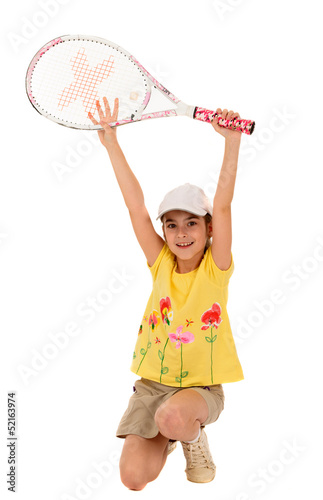 little girl with plays tennis on a white background