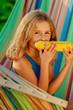 Child in the garden - lovely girl eating corn on the cob