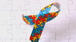 Autism ribbon falling onto jigsaw surface
