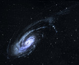 Spiral galaxy in deep space with star field background.