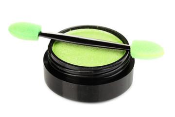 Bright eye shadows and sponge brush for foundation isolated