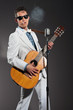 Retro rock and roll singer wearing white suit and black sunglass