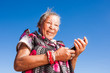 Elderly woman her new cellphone