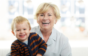 Smiling young boy and his grandmother