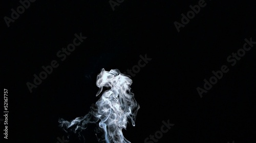 Rising white smoke on black background