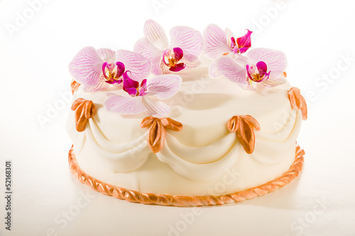 Tasty decorated cake in white marzipan coating