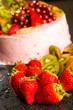 Fresh strawberries and kiwis with fruit cake
