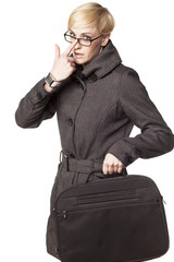blonde with short hair holding a laptop bag and adjusts glasses
