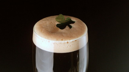 Shamrock landing on head of pint of stout