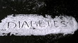 Diabetes spelled out in sugar blowing away