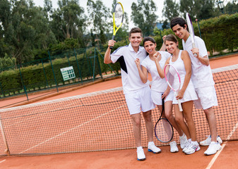 Tennis players celebrating
