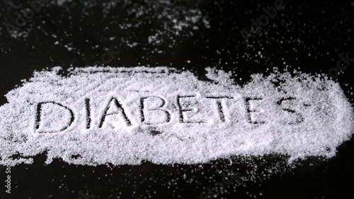 Diabetes spelled out in sugar blowing away
