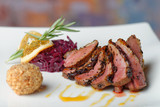 Duck breast fillet with red cabbage and potato ball.
