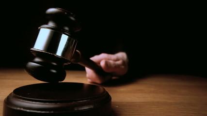 Judge hitting mallet off sounding block