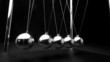Perpetual motion of newtons cradle close up
