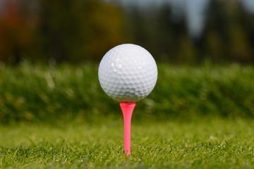Golf ball on tee shallow dof