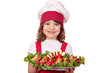 beautiful little girl cook with gourmet food