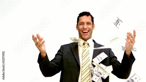 Businessman joyfully throwing his money