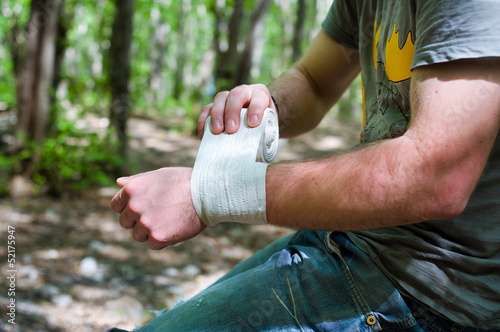 Applying an arm medical bandage