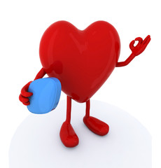 heart with big blue pill on hand