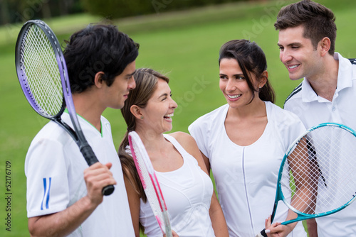 Happy group of tennis players