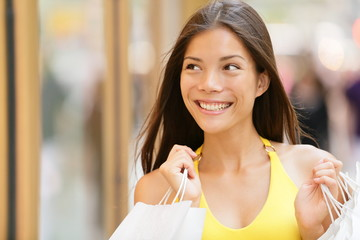 Shopping woman looking at shop window display