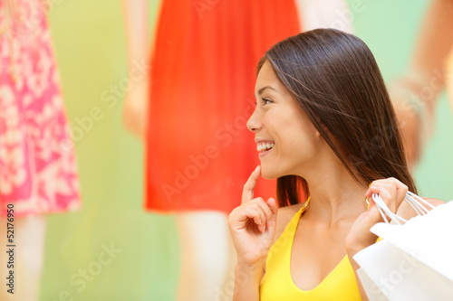 Shopping woman looking at window display at store