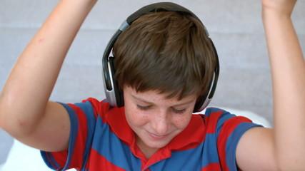 Young boy enjoying music with headphones