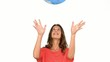 Woman throwing a globe in the air on white background