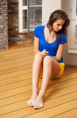 thinking woman sitting on the floor