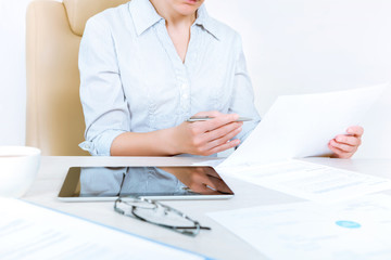 Businesswoman working with documents