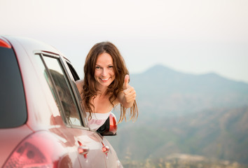 Happy driver woman on summer vacation