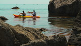traveler kayaking in the Black sea from backward view