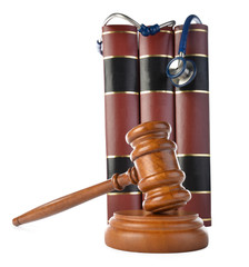Medicine law concept gavel and stethoscope isolated